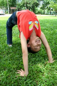 Summer Camp - Girl in Yoga Wheel Pose