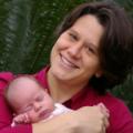 Jen Mueller - Headshot with Newborn Baby