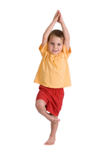 Young boy in tree pose, kids yoga