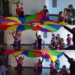 tot yoga playing with parachute
