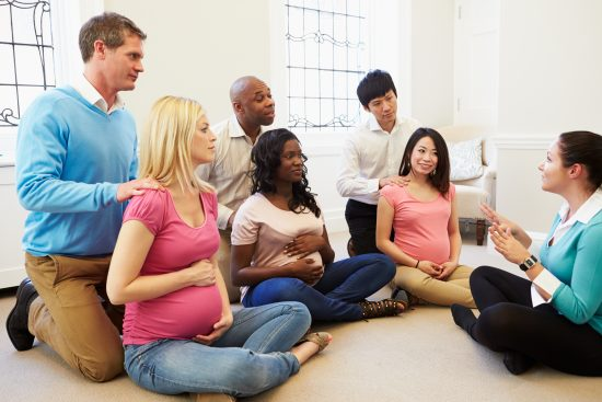 Couples Attending prenatal massage class