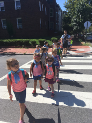 campers crossing the street