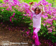 tree pose in front of spring flowers