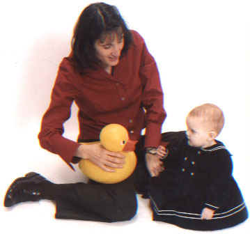 Eileen Ladino teaches sign language to baby