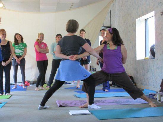 Jen demonstrates kids yoga partner pose