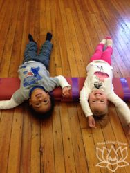 two year olds in supported fish pose