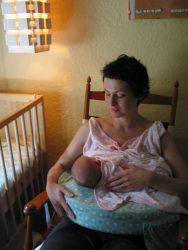 baby nursing, mom in rocking chair